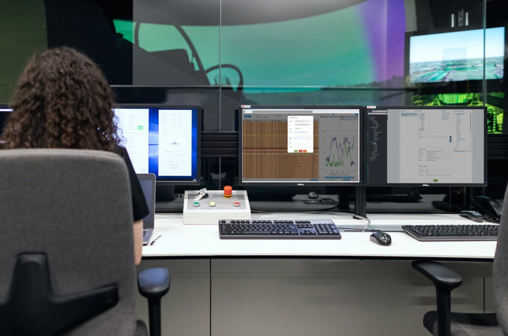 Woman in control room with screens