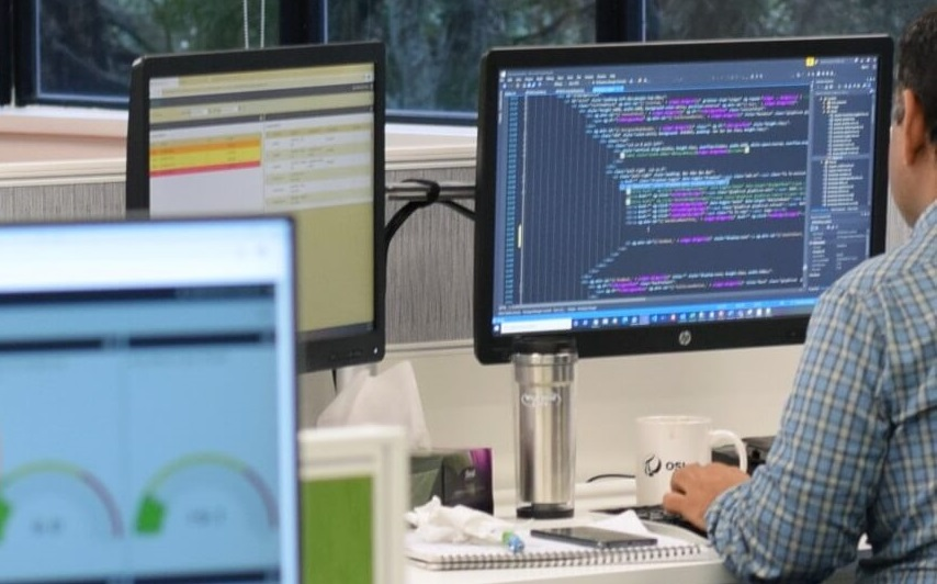 Man coding on screen